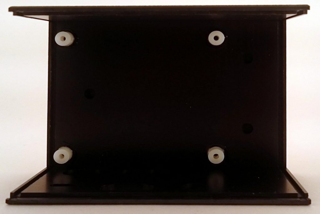 Fig. 1: The bottom of the housing has 4 domes for holding the SmartPi board and the distance bolts.